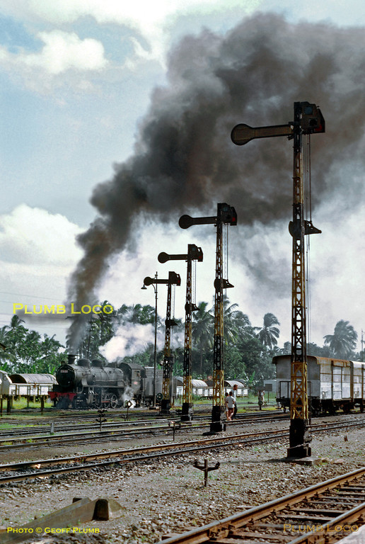 2-8-2 No. D51 03 is coming out of the loco depot at Kutoardjo, hopefully to work a train! The loco was built by Hartmann, No. 4131 of 1920, originally for the Hedjaz Railway but sent to Java instead. A wonderful line up of semaphore signals completes the scene. Saturday 21st July 1973. Slide No. 11544.