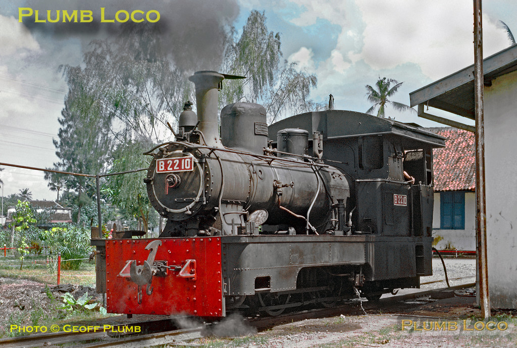 In steam outside Solo Balapan depot in Surakarta is 0-4-2skT (skirt tank) No. B22 10. This was built by Hartmann, No. 2558 of 1900. Sunday 22nd July 1973. Slide No. 11608.
