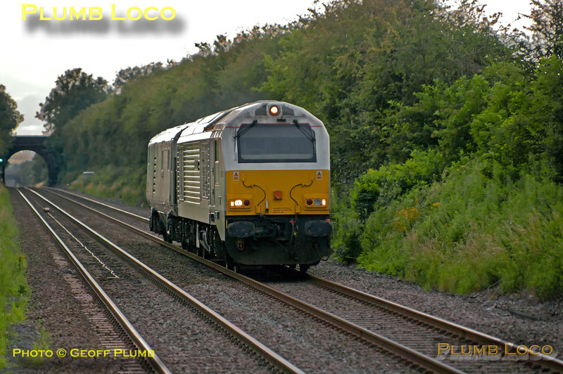 """Chiltern 67015 """"David J. Lloyd"""" with DVT 82303 is running as 5Z67, the 17:00 from Brush Loughborough to Wembley LMD, approaching Haddenham & Thame Parkway station at 20:03, a few minutes early. Not sure of the reason for the working, but nice ro see in any case! Thursday 19th July 2012. Digital Image No. GMPI12274."""