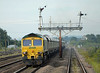 66530 heads through Barnetby with tehe 4R10 West Burton to Immingham empty hoppers on Monday 3rd August 2015