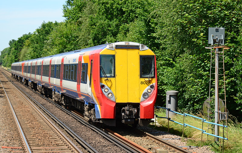 SWT Juniper units 458028+006 are seen arriving at Sunningdale heading for London Waterloo 03/07/2015.<br /> This the only set I saw in a two hour period, Desiro units are now the norm on the Reading services.
