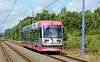 Midland Metro Ansaldo Breda T69 tram 10, is seen on the approach to Wednesbury Parkway heading for Birmingham Snow Hill 04/07/2015.<br /> My first visit to the Midland Metro. I had hoped to return to photograph the T69s as they were being withdrawn. However the last day was Friday 14th August. So this is my one & only shot of one in operation.