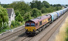 66160 with loaded biomass hoppers passes the new signal base at Knapp's Crossing on Monday 3rd August 2015