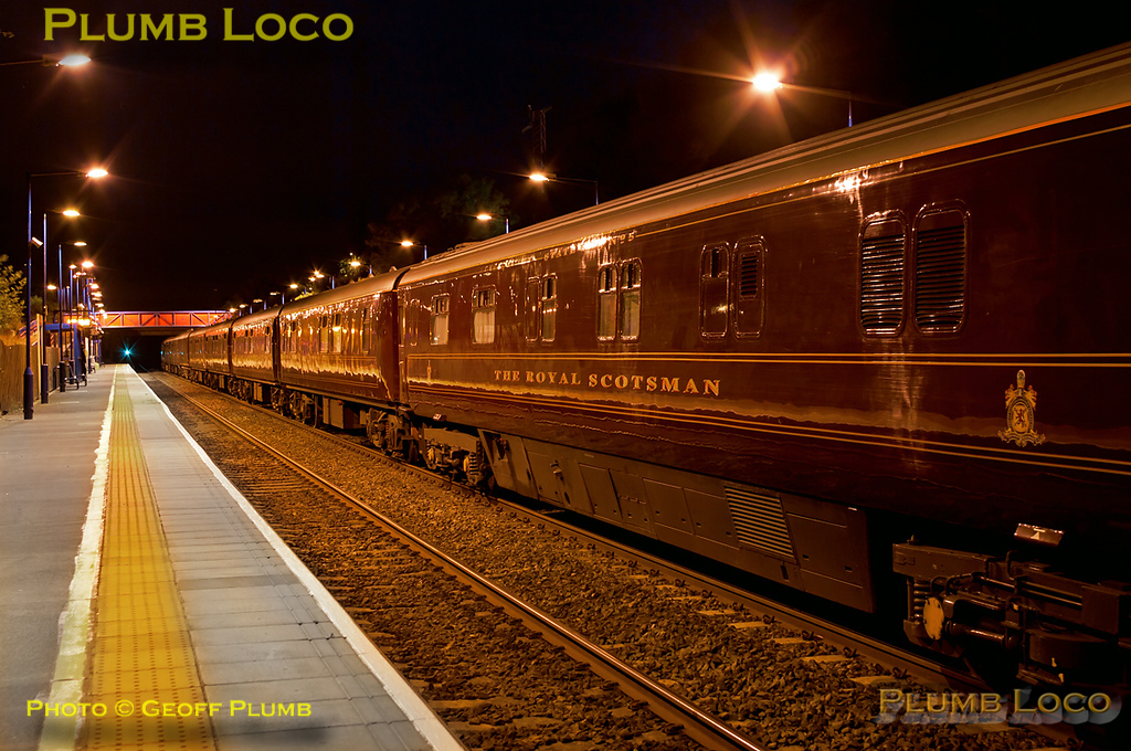 The Royal Scotsman train has now returned from reversing at High Wycombe and stands in the platform at Haddenham & Thame Parkway station whilst the passengers reboard after their dinner at Le Manoir aux Quat' Saisons. Unfortunately, as expected with such a long train, both locos were off the ends of the platforms, 57001 on the front (behind the camera) and 37685 on the rear. 22:40, Tuesday 12th July 2011. Digital Image No. GMPI9708.