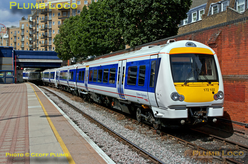 "Chiltern Railways held a short ceremony to mark the official launch into service of the Class 172/1s at Marylebone station on Friday 15th July 2011, though the units have now been in service for a little while. As part of the present diagram, the three units coupled together into one train spend much of the day stabled in the wall siding at Marylebone station and one of these, 172 102 was used for the ceremony. Having been uncoupled from the other two it was moved from the siding by a 165 unit which was also stabled there and then reversed into Platform 1. Here, it is seen being moved out of the wall siding at 14:28. Digital Image No. GMPI9726. There is also a ""3D"" version of this shot in the ""Three Dimensional!"" collection."