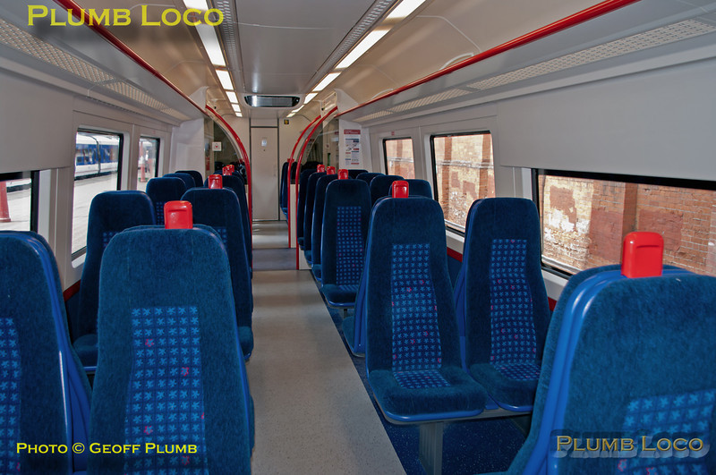 Intereior view of 172 102 at Marylebone during the official launch. Seating is a mix of bays of four and airline style bucket type seats, two either side of the aisle. Friday 15th July 2011. Digital Image No. GMPI9739.