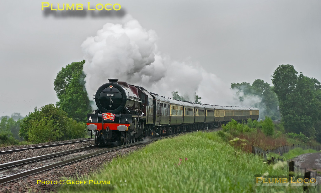 "Unfortunately running in awful weather, but still looking very nice, LMS ""Princess Royal"" 4-6-2 No. 6201 ""Princess Elizabeth"" is adorned with royal regalia as it works 1Z60, ""The Thames Diamond Jubilee Pageant"", 08:50 from Solihull to Kensington Olympia. Running a couple of minutes late or so, the loco is working hard as it approaches the foot-crossing at Clattercote at 09:36 on Sunday 3rd June 2012. Digital Image No. GMPI12188."