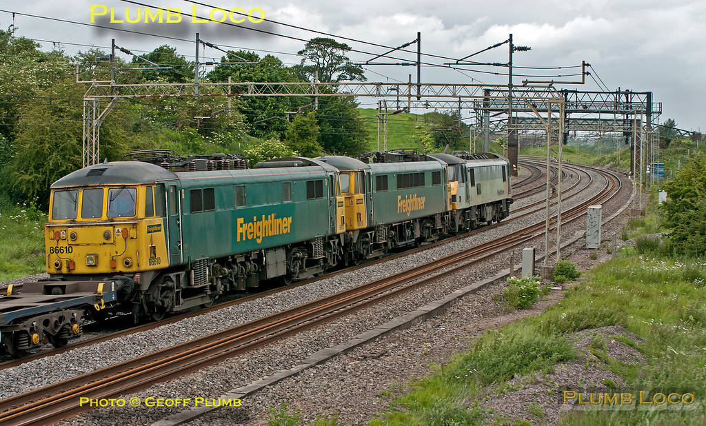 Freightliner 90043 is dragging two Class 86/6s, 86638 and 86610, DIT along the down slow line at Old Linslade on the WCML. The train was running as 4M52, Tilbury to Basford Hall, and consists of empty flat wagons. Apparently, 86610 had failed earlier. 09:56, Saturday 16th June 2012. Digital Image No. GMPI12195.