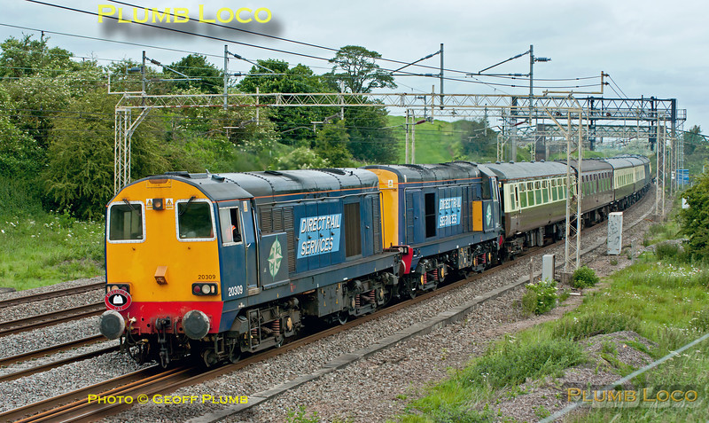 """DRS Class 20/3s Nos. 20309 and 20312 head 1Z42 south along the WCML at Old Linslade, 06:40 from Whitchurch (Shropshire) to Canterbury West excursion, carrying the """"Cheshire Cat"""" headboard. 10:37, Saturday 16th June 2012. Digital Image No. GMPI12203."""