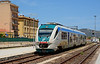 Standard gauge Trenitalia 3 car Minuetto Dmu number 059, arrives at Olbia with a service from Golfo Aranci.