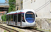 Sassari Ansaldo Sirio tram SS01 is seen on the approach to Stazione FS stop 24/06/2015.