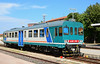 Single car Dmu ALn 663 1148 is seen at Olbia waiting to form its next service. This unit having visited the workshops at Sassari for repaint & having had new light clusters fitted.