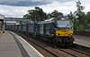 68002 Intrepid southbound through Kingussie with a toot on 13th June 2016