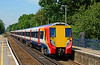 SWT Juniper 458005 arrives at Sunningdale with a service to London Waterloo 19/07/2014. This unit is next in line for despatch to Wabtec Doncaster for rebuild.
