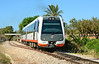 Dmu 2511 departs Benissa heading for Denia 03/07/2014. My understanding is that this line will be converted to Tram operation by 2020.
