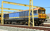 58024 is seen in faded Continental Rail livery basking in the spanish sun. It was 30 degrees + when I took the pictures over the fence that surrounds them.