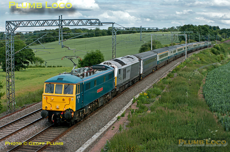 """The """"Three Peaks Challenge by Rail"""" special, 1Z50, ran once again this year in aid of the Railway Children Charity. Due to depart from Euston at 15:54, it was delayed by difficulties with the coaching stock, eventually leaving around 20 minutes late. 86101 """"Sir William A. Stanier FRS"""" leads the 11 coach train together with 67013 """"Dyfrbont Pontcysyllte"""" soon after passing Roade and approaching Blisworth at 17:13 on Thursday 23rd June 2011. The electric loco was working as far as Crewe, the 67 then taking over for the run to Bangor and the first climb for the participants of Snowdon. Digital Image No. GMPI9512."""