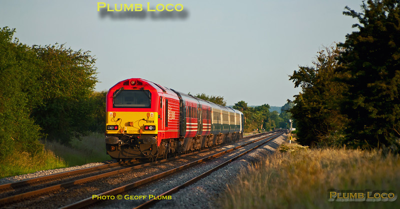 "67018 ""Keith Heller"" is still in action for the Chiltern LHCS services, seen here on the rear of 5U08 at Kingsey foot-crossing. This is the 05:22 ECS train from Wembley LMD to Banbury to commence the week's running on 1H08, the 06:53 from Banbury to Marylebone and 1U53, the 18:06 return from Marylebone to Banbury. It is running a few minutes early at 05:51 on Monday 27th June 2011 in the first of the morning sunlight."