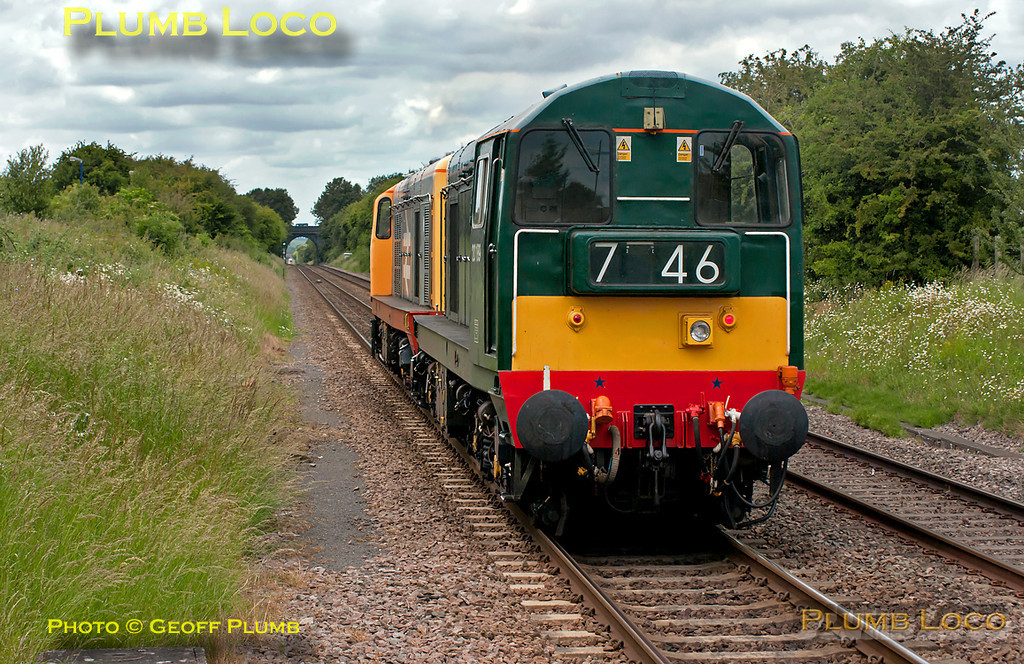 "Class 20s Nos. 20227 and 20189 worked light engines as 0Z20, 13:00 from West Ruislip LUL Depot (where they are normally based) to Bescot, on Monday 20th June 2011. The pair are seen passing through Haddenham & Thame Parkway, running on time at 13:50. They were due to recess overnight at Bescot before continuing to Butterley, where 20227 was due to be dropped off, 20189 proceeding to Barrow Hill for attention to its bogies. The headcode 746 is an LUL code which 20189 has carried during its recent duties accompanying Met Electric No. 12 ""Sarah Siddons"". Digital Image No. GMPI9497."