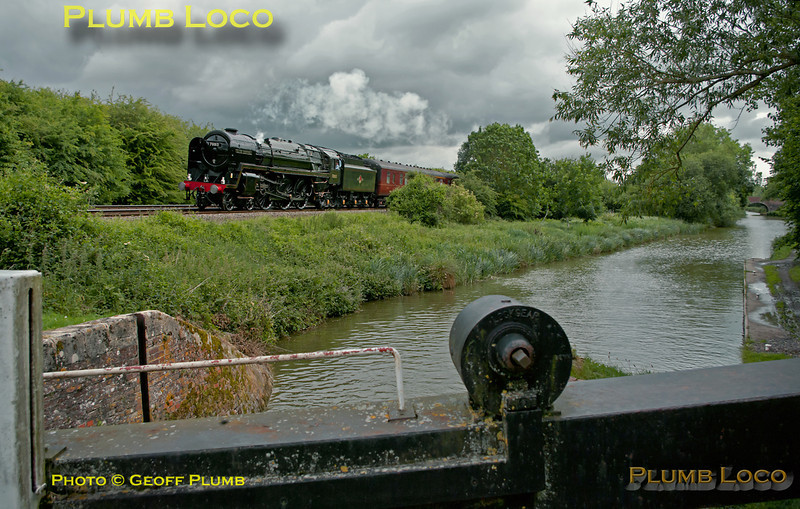 "70013 ""Oliver Cromwell"" had stopped for water at Newbury Racecourse station and is now on the climb to Savernake summit at Froxfield Lower Lock, alongside the Kennet & Avon canal. Only a hint of sunshine here as the thicker clouds roll in... 10:38, Saturday 18th June 2011. Digital Image No.GMPI9448."