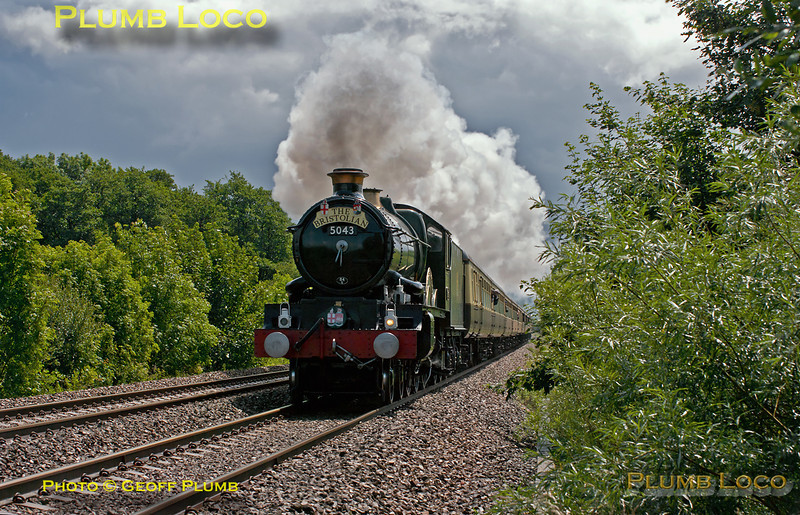 """The heavens had opened a short while before and it absolutely poured, but fortunately, the sun came out again a couple of minutes prior to 5043 """"Earl of Mount Edgcumbe"""" coming into view, and what a sight! The engine is going all out as it gets to grips after the water stop at Newbury Racecourse, here seen approaching a foot-crossing just west of Kintbury. The train is 1Z50, """"The Collett Express"""", though it is carrying """"The Bristolian"""" headboard. It departed from Solihull at 07:05 and is bound for Bristol at 12:00 on Saturday 18th June 2011. Digital Image No. GMPI9459."""
