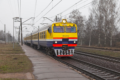 DMU DR1A-267.8 passes Gaisma forming the 15.25 Riga to Krustpils service. Monday 7th April 2014.