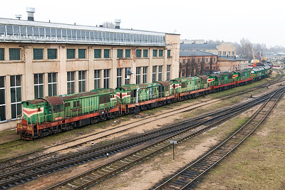 An interesting line up of stored and operational locomotives outside Riga Depot consisting of, ChME3-1307, 1303 & 1304 all Ex Estonian Railways from Muuga Docks, LDz ChME3-6192 & 6138, 2M62US-0118 & TEP70-0268. Monday 7th April 2014.