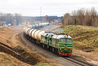 Baltic Transit Services' 2M62-0345 climbs away from Krustpils with southbound empty tanks from Ventpils. Tuesday 8th April 2014.