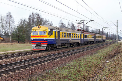 4 car EMU ER2T-2207.01 departs from Ikskile forming Train 6219 Lielvarde to Riga. Tuesday 8th April 2014.