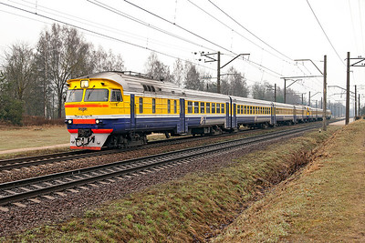 The 04.51 Krustpils to Riga formed of two 4 car DMU's DR1A-187.1 & DR1A-172.1 pass through Ikskile in the morning gloom. Tuesday 8th April 2014.