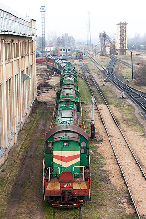 An interesting line up of stored and operational locomotives outside Riga Depot consisting of, ChME3-1307, 1303 & 1304 all Ex Estonian Railways from Muuga Docks, LDz ChME3-6192 & 6138, 2M62US-0118 & TEP70-0268. The sanding tower can be seen in the background on the right. Monday 7th April 2014.
