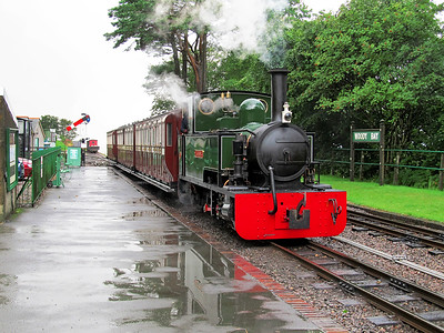 Bagnall built ISAAC arrives at a very wet Woody Bay station with the first train of the day. Sunday 10th August 2014.