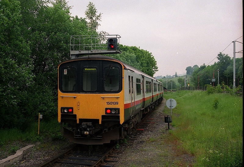 150139 in GMPTE livery departs Oxenholme with a Lakes Line service for Windermere, 13/5/1998.
