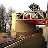 The rebuilding of the train shed over the Lakes Line platform (platform 3) at Oxenholme is well under way in this scene from 23/12/2000 with most of the iron work back up and the new concrete wall being faced with the original stone as 158756 prepares to depart with the 13:34 service to Windermere.