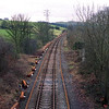 During 2002 the Lakes Line was closed for 2 weeks for the old 60ft jointed track to be relayed with long welded rail. This is the start of a series of pictures showing the work progress and the trains bringing in the ballast.<br /> This view taken from Milepost bridge looking towards Oxenholme on 3/3/2002 shows the new steel sleepers and new rail laid out ready for work to start.