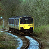 Still in original Sprinter livery 150145 departs Oxenholme with the 14:38 service to Windermere, 29/3/1999.