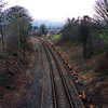 This view taken from Milepost bridge looking towards Kendal on 3/3/2002 showing the new steel sleepers and new rail laid out ready for work to start.