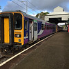 153360 and 156488 stand in platform3 at Oxenholme waiting to depart with the 13:33 to Windermere, 17/10/2016.<br /> Note the modified canopy awning to accommodate the OHLE, which for the foreseeable future will only extend the length of the platform.