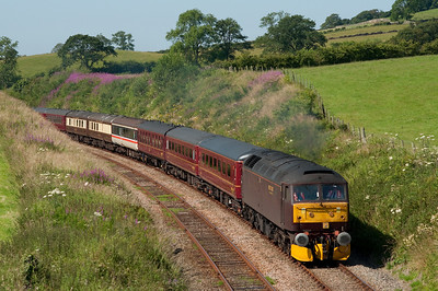 47760 hauls empty stock from Carnforth-Saltburn at Keer Holme 14/7/11.