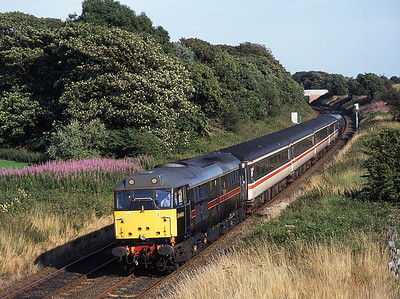 31468 hauls a Blackpool North bound club train at Weeton with 31459 on the rear, 30/7/04.