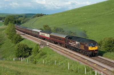A return Leeds-Glenrothes SRPS charter passes Otterburn on 11/6/11 hauled by 47826 in its Scarborough Spa Express advertising livery.