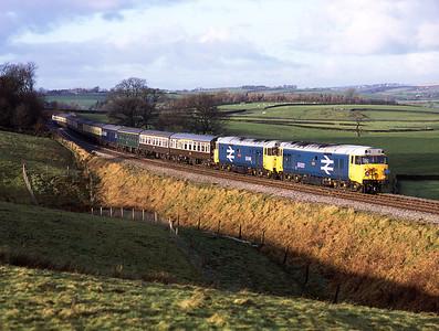 50031+50049 pass Eldroth with a Cardiff-Leeds railtour 16/12/06.