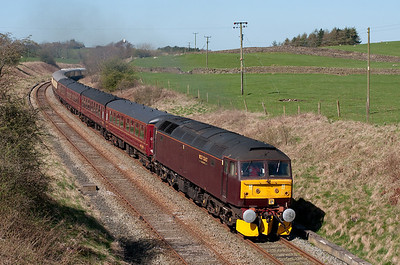 A Carnforth-Ely empty stock move hauled by 47760 passes Paley Green 8/4/11.