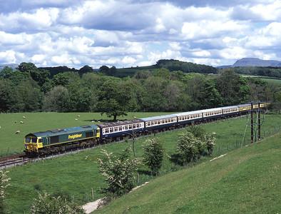 With Ingleborough in the distance, 66608 hauls a Reading-Heysham-Preston tour near Wennington on bank holiday Monday 30/5/05.