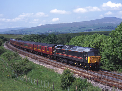 """Former shove duff 47709 """"Dionysos"""" passes Kettlesbeck with a Carnforth-Heaton empty stock move 7/6/03."""
