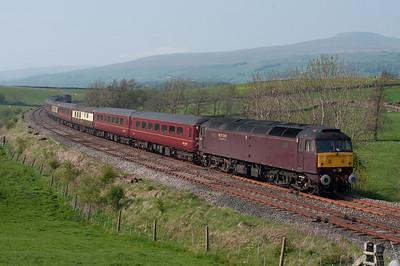 A Carnforth-Bridlington empty stock passes Kettlesbeck top and tail with 47804 and 47786 on Royal wedding bank holiday 29/4/11.