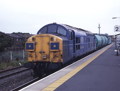 37023 stands in the Heysham platform of the new Morecambe station with the weedkiller train 16/8/98.  Out of sight at the rear is 37114 which has just derailed on the sprung points for the run round loop!