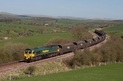 66523 hauls a coal train near Newsholme 8/4/11.