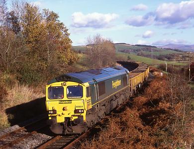 66604 hauls a Horrocksford-Basford Hall spoil train near Borwick 12/11/08.