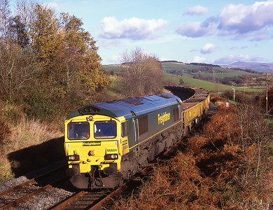 66604 hauls a Horrocksford-Basford Hall spoil train near Borwick 12/11/08.